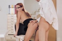 Redhead secretary rides dick at the office