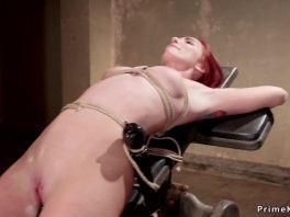Redhead slut suspended and spinned picture slut