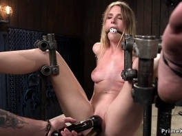 Babe bound in device pierced pussy toyed picture slut